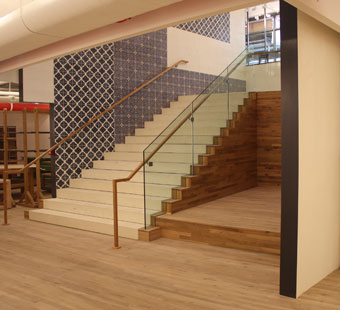 Glass guardrails & wood handrails provided by IMS.