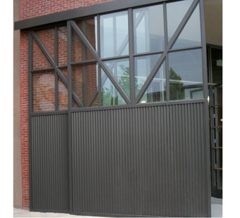 Large sliding aluminum doors with matte black finish after final installation