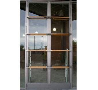 Aluminum and glass storefront doors with 4 rows of horizontal wood dowel pulls